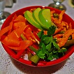 Chicken curry rice bowl if packed full of flavor with red peppers, pickled carrots, green beans,