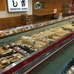The sushi counter. You grab what you want, and pay at the casher, who wil give you the soy sauce