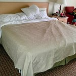 This was the bed AFTER housekeeping had finished. Room wasn't vacuumed. Bathroom was dirty.