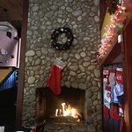 Christmas decorations and fireplace in the main dining room