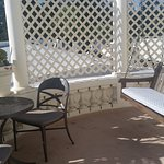 Private patio and porch swing off hotel room. Great to read paper and eat breakfast