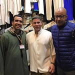 Abdul and my husband shopping at a tailor's shop