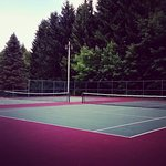 Private tennis courts on site.