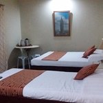 superior room with a single bed and a queen bed, with TV and aircon and 3 electrical outlets