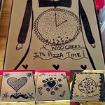 Pizza boxes doodled on by the chef/owner's 11 year old daughter
