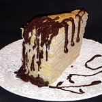 Crepe cake slice with chocolate sauce