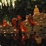 Novice monks preparing for the Yi Peng Eve prayer session