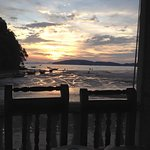 Sunset from a restaurant on the beach. Everyplace has fresh crab. It's fantastic...and cheap!