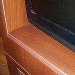 Meuble TV poussiéreux