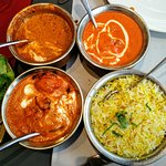 Saffron basmati with daal makhni, butter chicken, and shrimp malabar