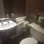 Compact en-suite; no vanity unit.