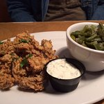 Fried oysters with green beans.