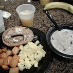 fruit, juice, breakfast potatoes, eggs, oatmeal