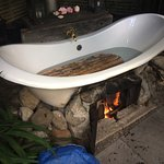 Outdoor bath heated with fire underneath. Jan lights the fire about 4pm. It is hot by 5pm.