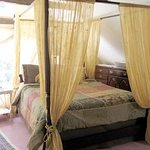 The Treetop Suite with gas fireplace, 4-poster canopy bed, private bath, palladium window, kitch