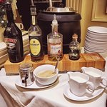 Amazing breakfast set up includes porridge with booze.
