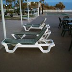 The only shaded lounge chairs - facing away from the ocean.