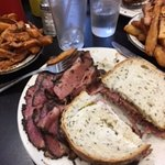 Pastrami platter with garlic fries, pickles and coleslaw.