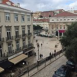 View of National Theatre (pink poster) and corner of Rossio Square from Mar apartment living roo