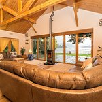 Loch view lounge with wood burning stove and stunning view