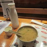 Accompany the sushi is miso soup and hot sake
