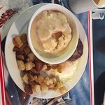 Sampler No. 1, Biscuit with gravy, potatoes, sausage patty with one egg.