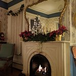 Fireplace mantel in our parlor decorated for the holiday season
