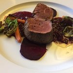 Beef fillet on thinly sliced beetroot , crispy Brussel sprouts and red wine sauce