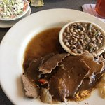 Veggie plate on the left.  Roast beef and gravy with two sides.   Front of menu.