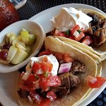 Breakfast Tacos with a side of fresh fruit. The brisket was so tender and DELISH!
