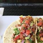 Olio Restaurant one block behind Hyatt. I had the very best fried shrimp tacos ever!