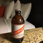 Desk beside bed is great for working and also supporting your nightly Red Stripe ;)