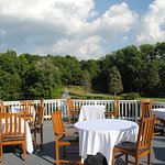 Beautiful outdoor dining overlooking the golf course and lake