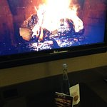 Fireplace greeting (on the t.v.) along with sparkling water greets me on the first night