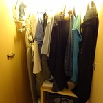 Tiny closet with safe & two drawers, also iron & ironing board