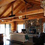 Massive log lodge with 3 livings, two kitchens, 5 bedrooms and 3 baths.
