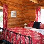 Queen-sized iron bed with rustic Ralph Lauren bedding.