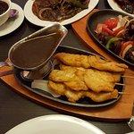 Chicken on sizzling platter