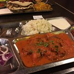 Chicken Tikka Masala with rice and yogurt sauce. The chutney adds a nice heat to the dish.