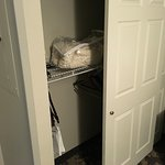 The ADA room closet is at standard, the top shelf is not reachable by a chair bound guest.