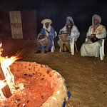 Nomads playing music around the fire