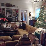 Large sitting room. Vintage books. Decorated 12 ft Korean Fir.