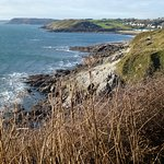 About 10 minutes around the 1st headland from Fortes you see Langland Bay
