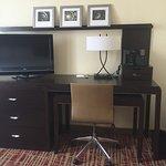 Television, desk area and dresser