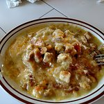Open//Flat Chicken Enchiladas with green chili sauce.