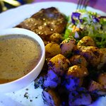 Pepper sauce steak with potatoes. We would rather not comment on this dish