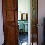 the spacious turquoise bathroom