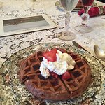 Yep, it's a chocolate waffle with fresh berries and cream!
