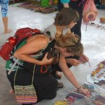 Tourists selecting from the Artesan collections on Market Day