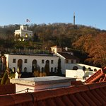 View of the hotel gardens and Petrin Tower from the roof terrace